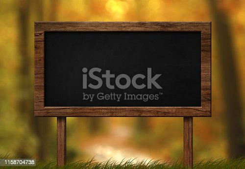istock Large blackboard with autumn forest background 1158704738