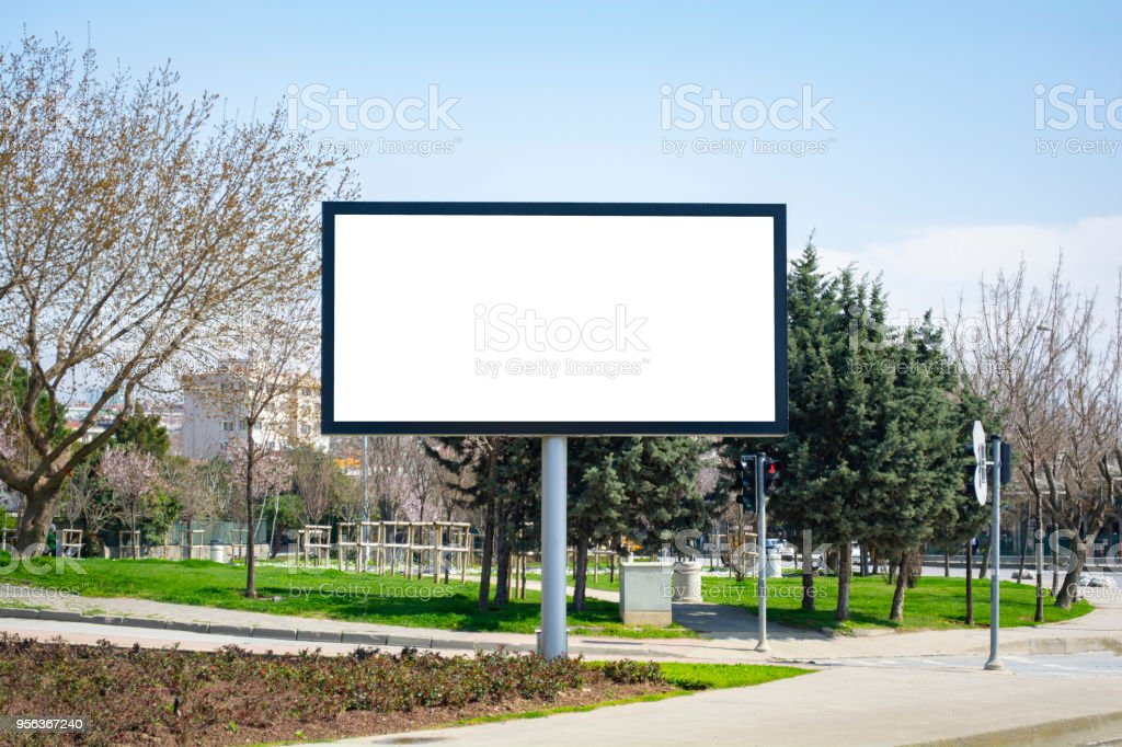 Large blank billboard located on the side of the road. stock photo