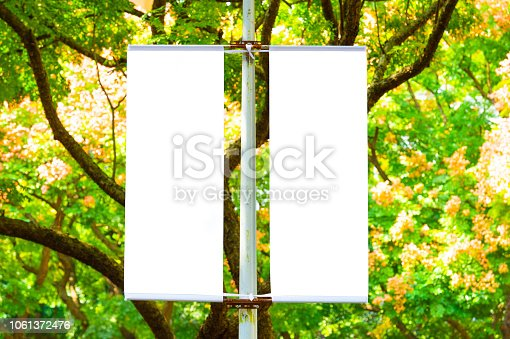 istock Large blank billboard on a street wall, banners with room to add your own text 1061372476