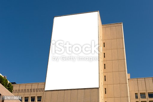 istock Large blank billboard on a street wall, banners with room to add your own text 1076119354
