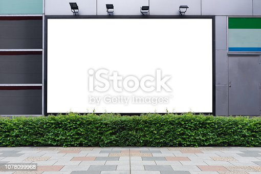 istock Large blank billboard on a street wall, banners with room to add your own text 1078099968