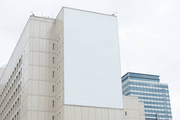 large blank billboard on a street wall,  banners with room to add your own text - ad template stock photos and pictures