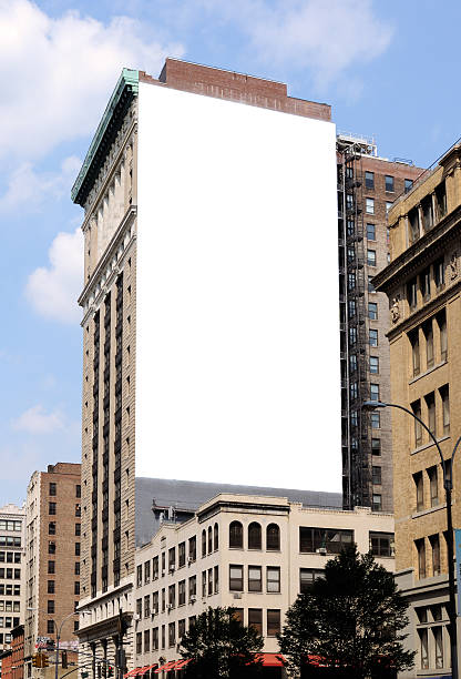 Large blank billboard on the side of a city building stock photo