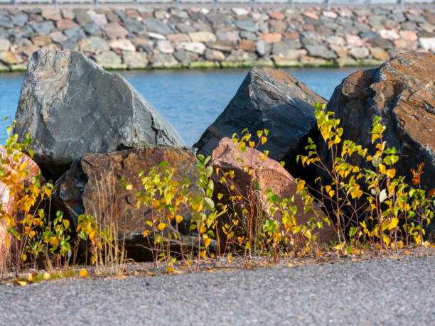 Large blocks of granite right next to the waterfront. stock photo