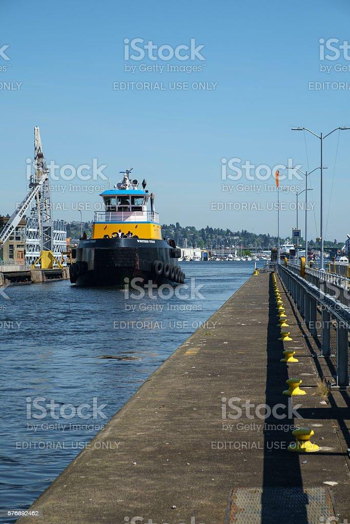 Large blue and yellow tugboat at Ballard Locks, Seattle stock photo