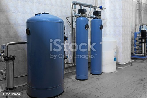 1132919452istockphoto Large blue cylinders with pressure control 1132919454