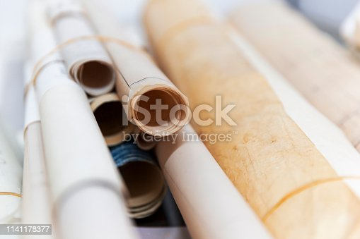 istock Large Blue Print Scrolls Bound Together By Elastic Bands 1141178377