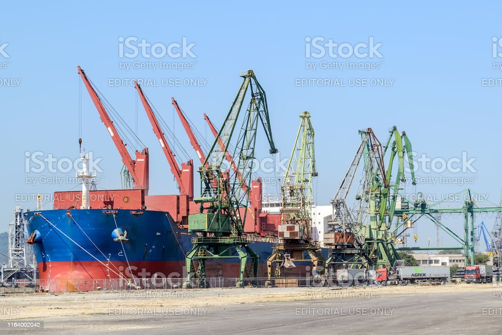 Varna, Bulgaria, July 22, 2019. Large blue red sea cargo ship while...
