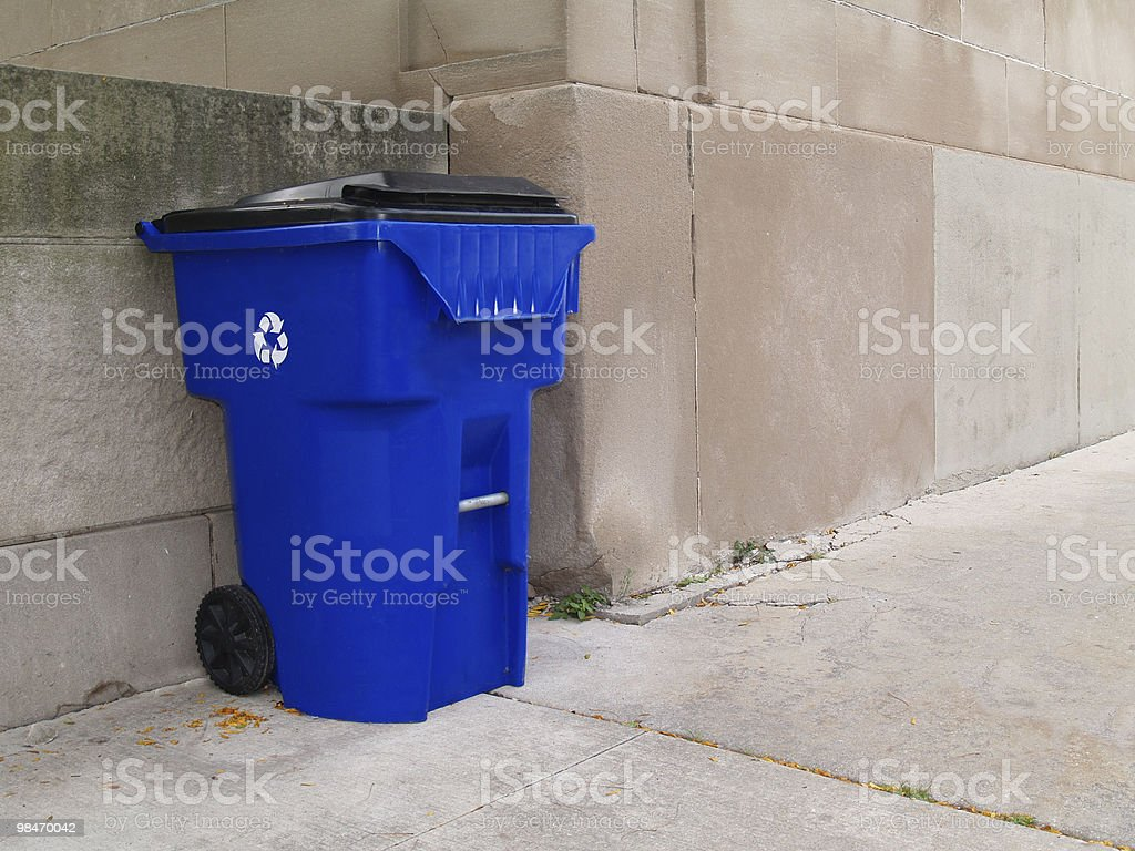 Large Blue Trash Can on a City Sidewalk royalty-free stock photo