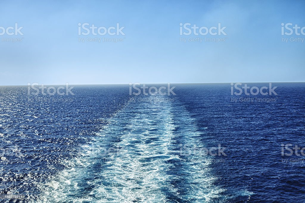 Large boat wake on the ocean stock photo