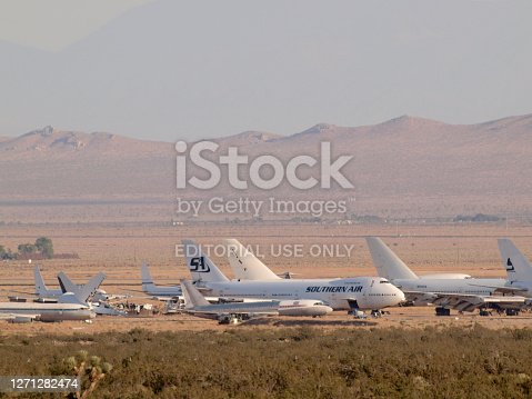 istock Large Boeing 747 Southern Air Plane, McDonnell Douglas, Lockheed, and Airbus aircraft owned by major airlines parked at storage facility 1271282474