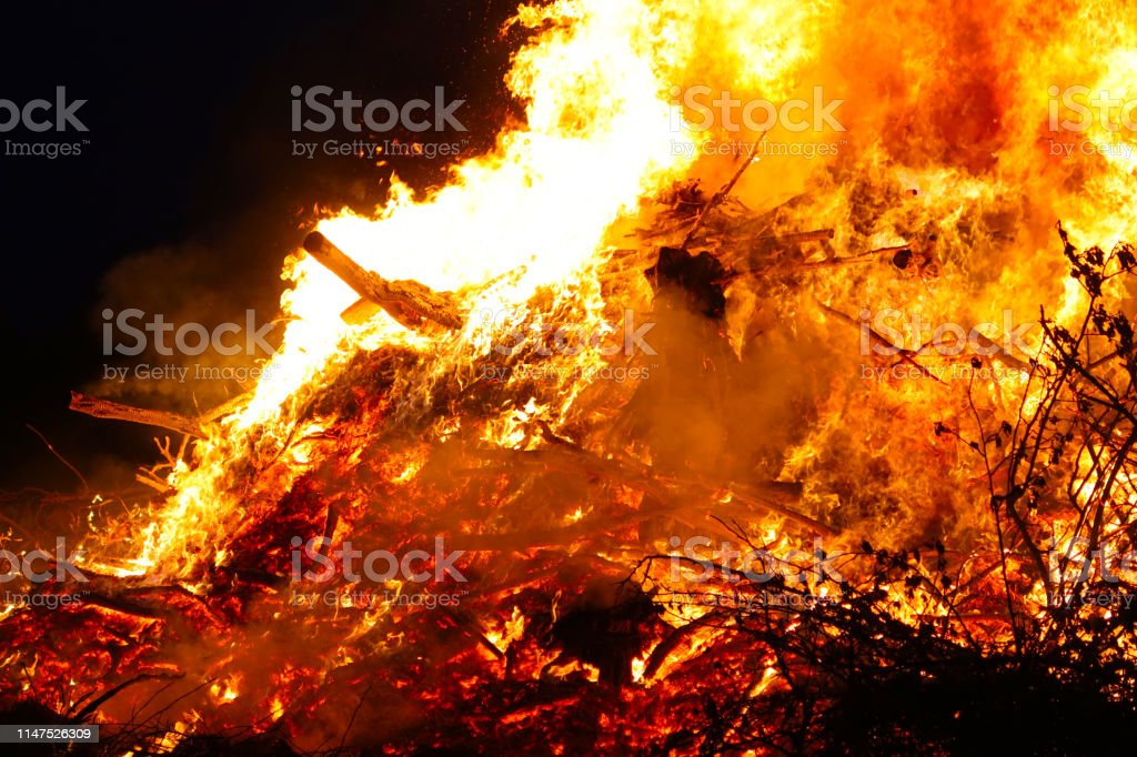 Large bonfire, burning and glowing with soft flames, sparkles flying...