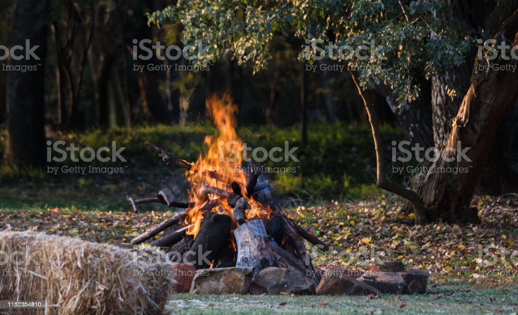 A large bonfire lit to warm up festival patrons on a chilly Autumn...