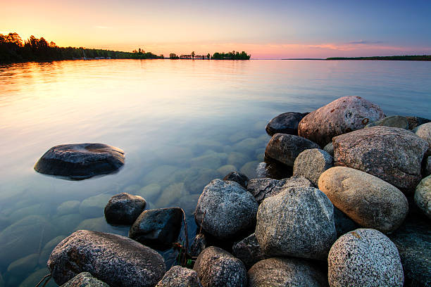 Large boulders on lake shore at sunset. Minnesota, USA Large boulders on lake shore at sunset. Minnesota, USA minnesota stock pictures, royalty-free photos & images