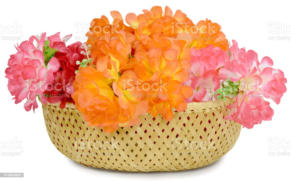 large bouquet of artificial flowers basket stock photo