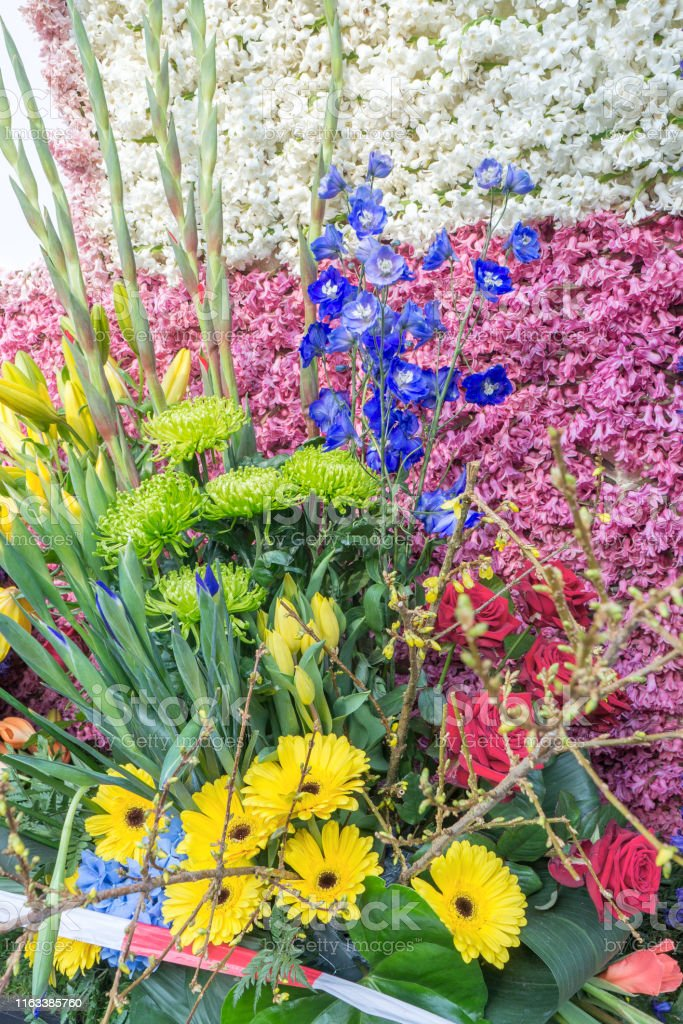 A large bouquet of different flowers, different colors.