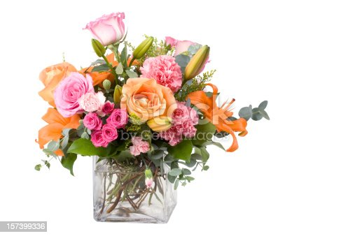 A pretty bouquet of different flowers isolated on a white background.