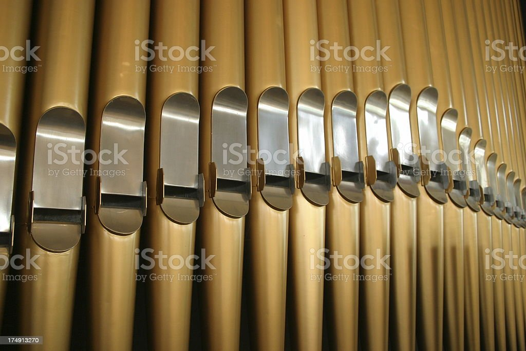 Large brass and steel pipe organ closeup stock photo