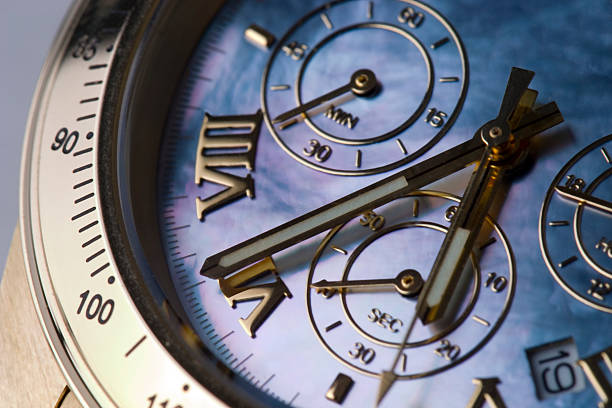 A large brass chronograph with hands moving stock photo