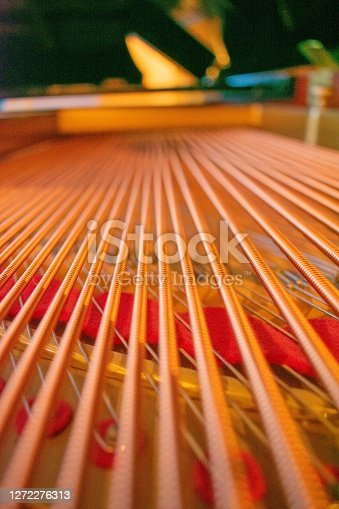 A Low Angle Shot of Large Brass Strings of a Grand Piano