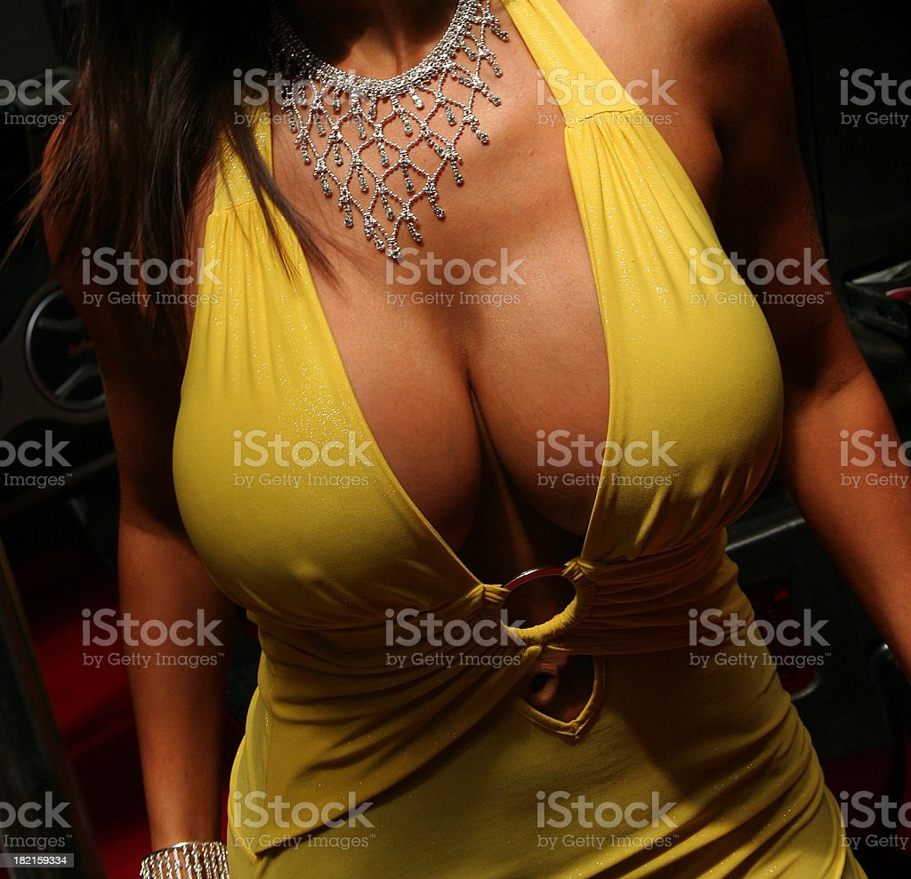 Large breasted woman in a yellow dress​​​ foto