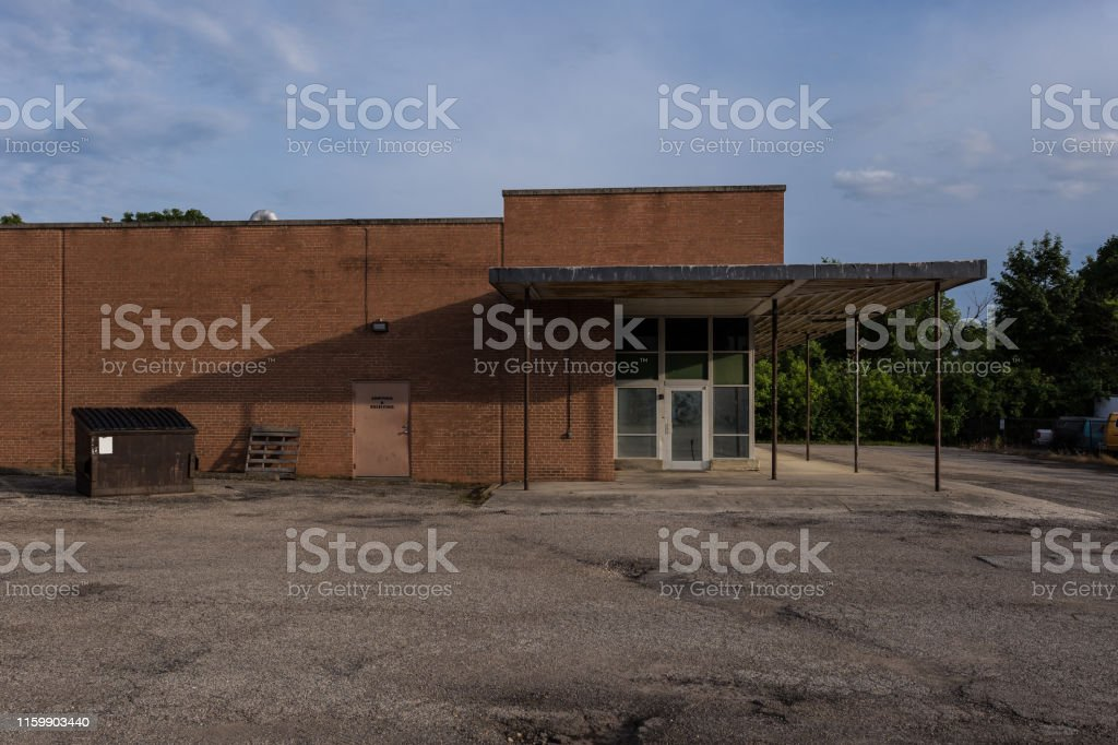 Large brick retail building left empty in a midwestern suburb on a...
