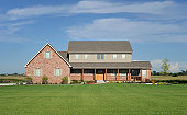 Large, two story, brick house in rural Illinois