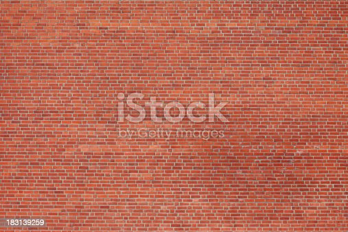 Large red brick wall shot from a distance.