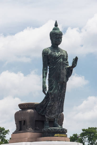 Large Bronze statue Walking Buddha Thailand South East Asia Travel Concept. stock photo