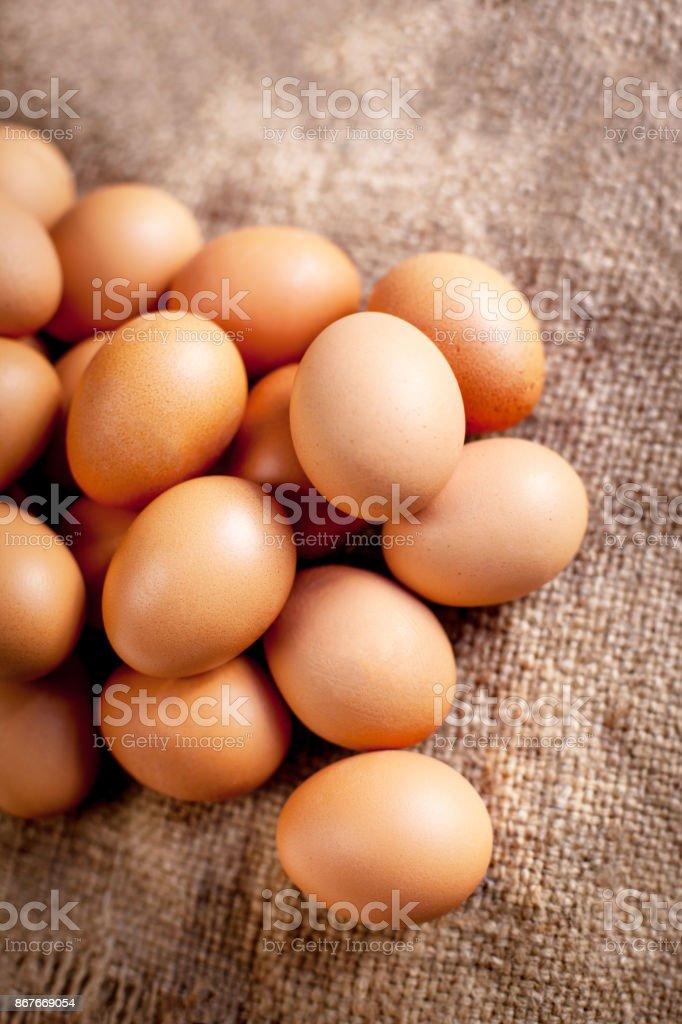 Large brown  Eggs on burlap   background closeup stock photo
