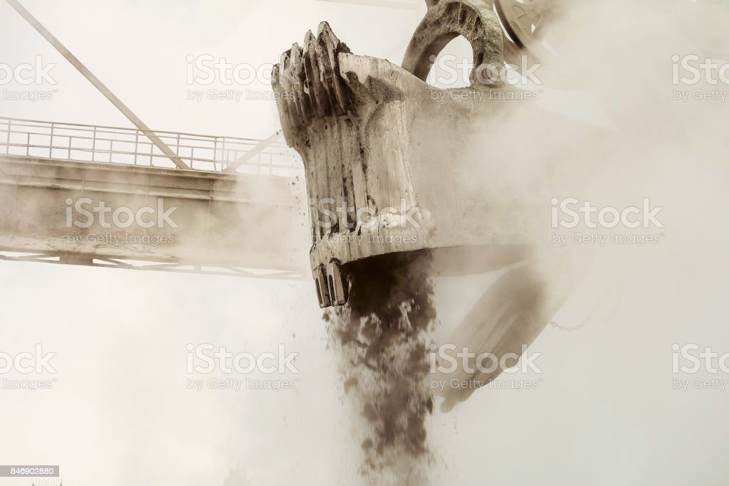 Large bucket of mining excavator with mechanical drive and flexible suspension of working equipment in the process of excavation stock photo