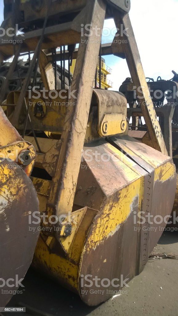 Large buckets for port loaders. Dreglayner, Hydraulic and cable devices for gripping loose material stock photo