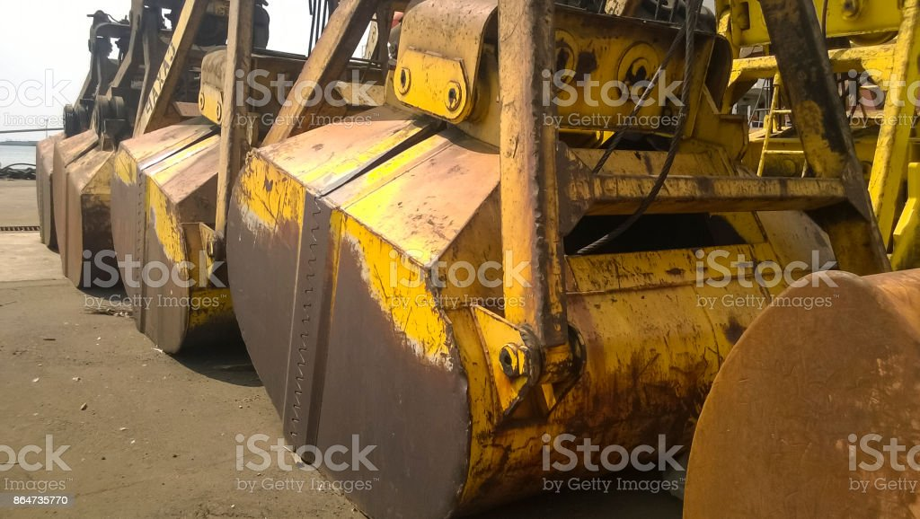 Large buckets for port loaders. Dreglayner, Hydraulic and cable stock photo