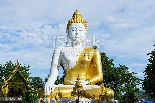 Chiang Mai, Thailand - July 7, 2020 : Large Buddha statue at Wat Phra That Doi Kham.
