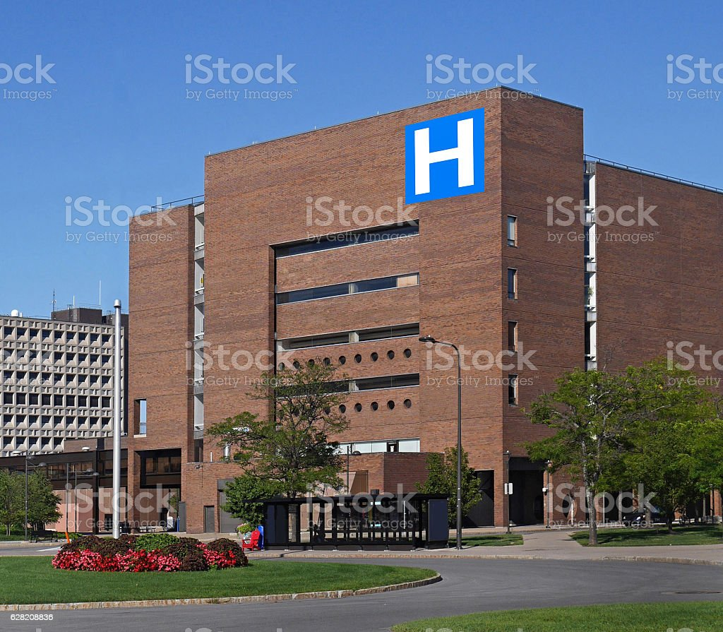 large building with H sign for hospital stock photo