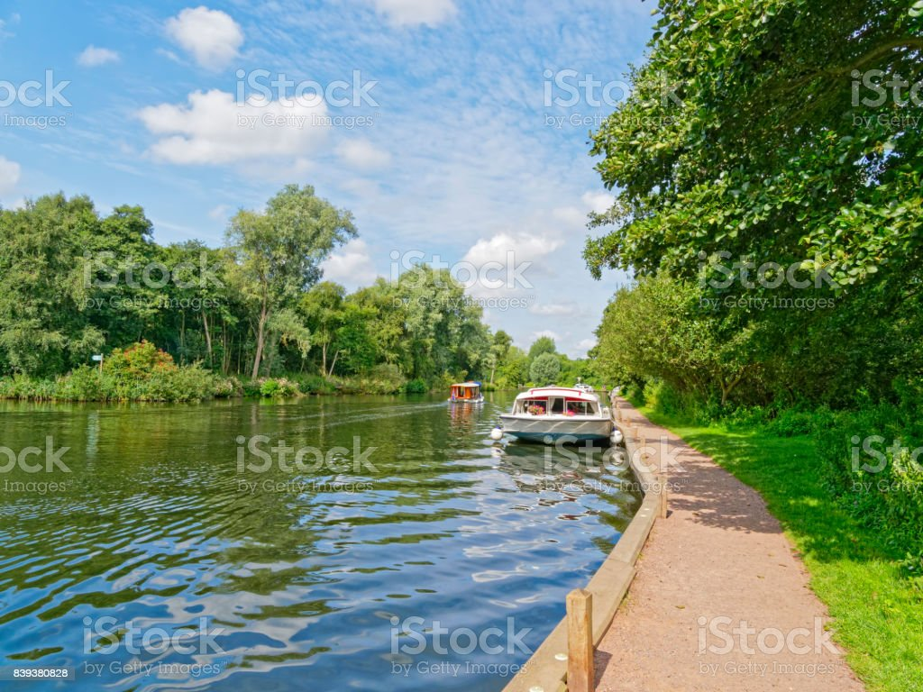 Large Cabin Cruiser moored on the River Bure. stock photo