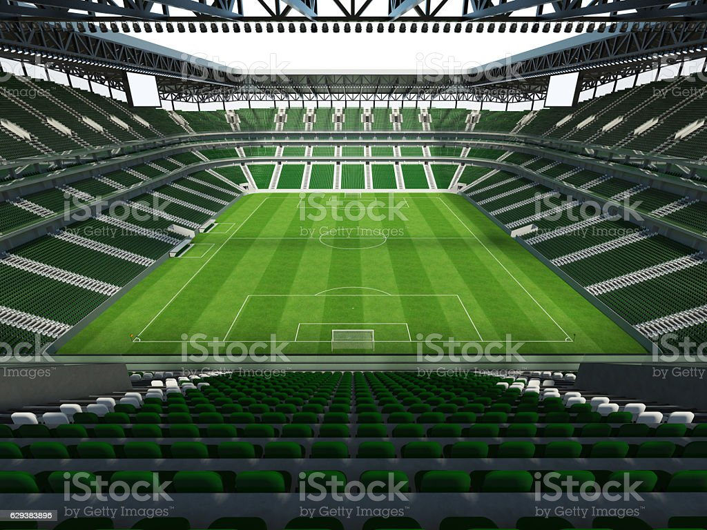 Large capacity soccer-football Stadium with roof and green seats stock photo
