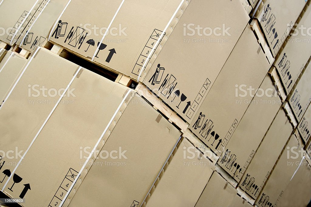 Large cardboard boxes on wooden pallets stacked royalty-free stock photo