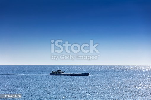 istock large cargo boat transporting in the ocean 1125609676