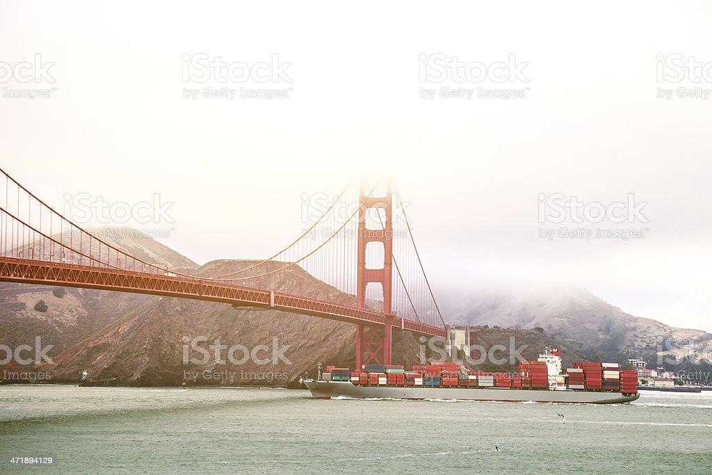 Large cargo ship passing on Golden Gate Bridge royalty-free stock photo