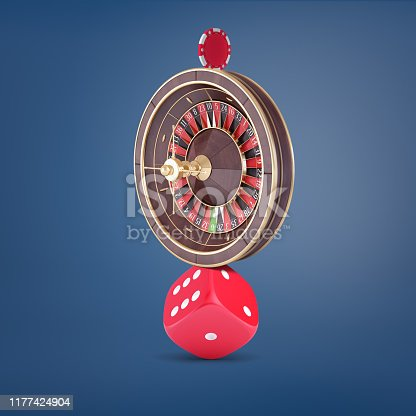 A large casino roulette balancing on a large red dice and holding a casino chip on the top. Casino gambling. Balancing life and games. Addiction to gambling risk.