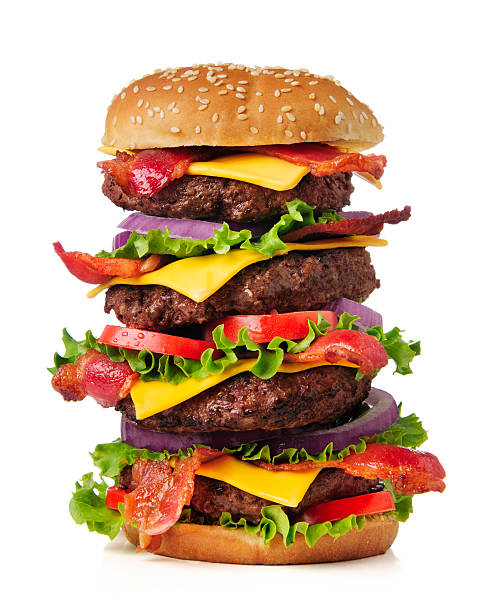 Large Cheeseburger Exaggerated multi-layered bacon cheeseburger on white background.  Please see my portfolio for other food and drink images. bacon cheeseburger stock pictures, royalty-free photos & images