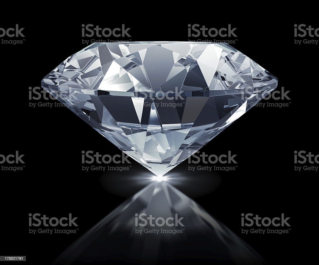 Large clear diamond against black background stock photo
