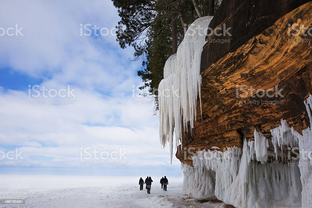 Large Cliff with Icicles, People, and Copy Space stock photo