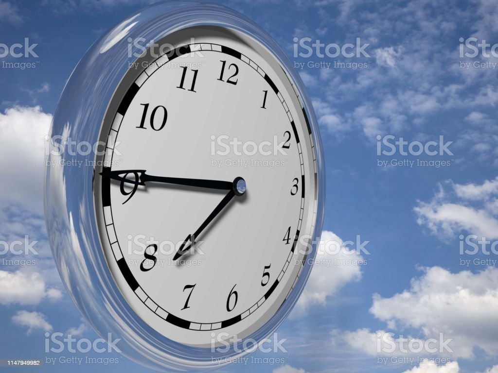 Large clock face with hands that mark the hours on sky background