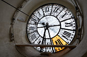 Large clock-face of old mechanical clocks on a tower in a church, inside view