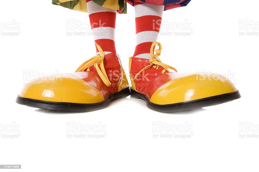 Large clown feet in yellow and red shoes stock photo