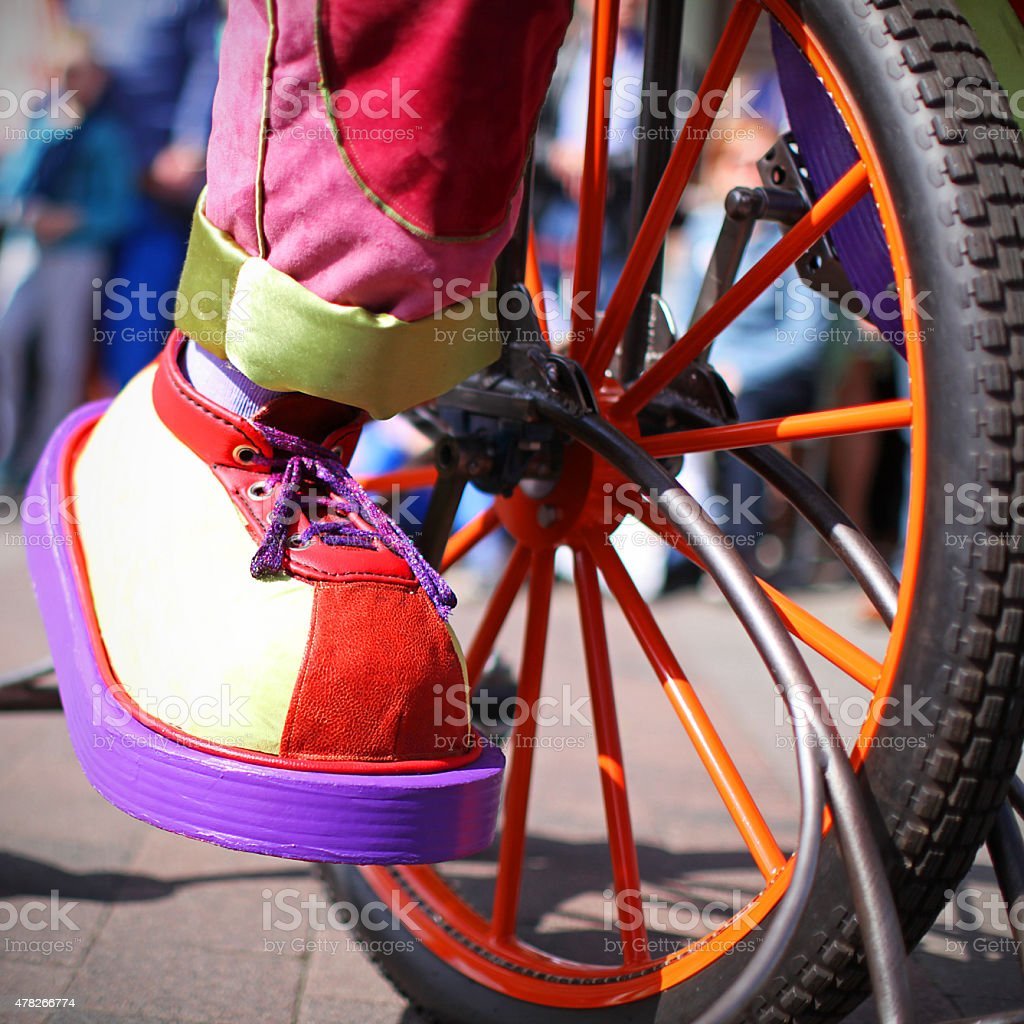 Large Clown Shoe on a Unicycle Close-up stock photo