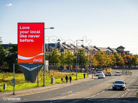 istock Large Coca Cola advert on city street 1278058289