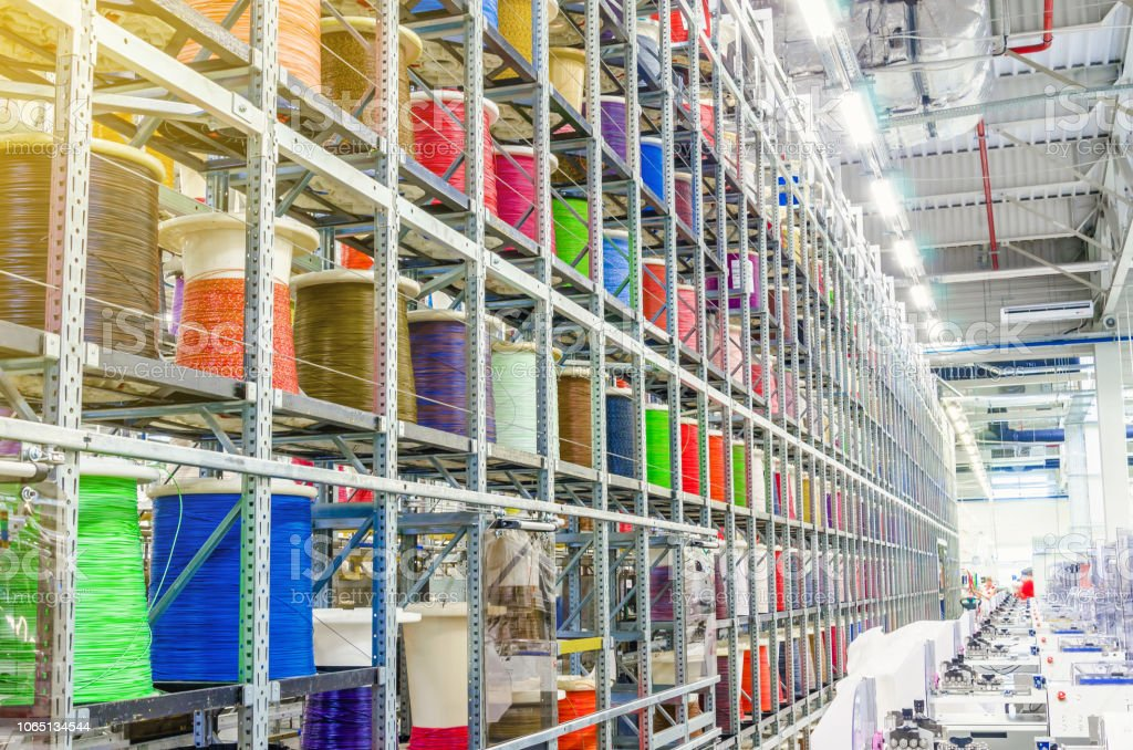 Large Coils With Colored Electrical Wires On Huge Shelves In An Industrial on